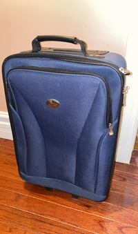 Rolling suit case for sale