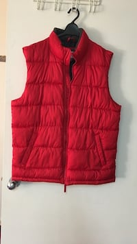 Red zip-up bubble vest.