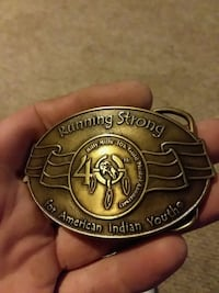 brass-colored Running Strong for American Indian youth emblem