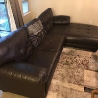 Tufted brown faux leather sofa