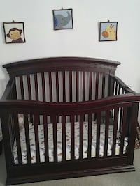 baby's brown wooden convertible crib