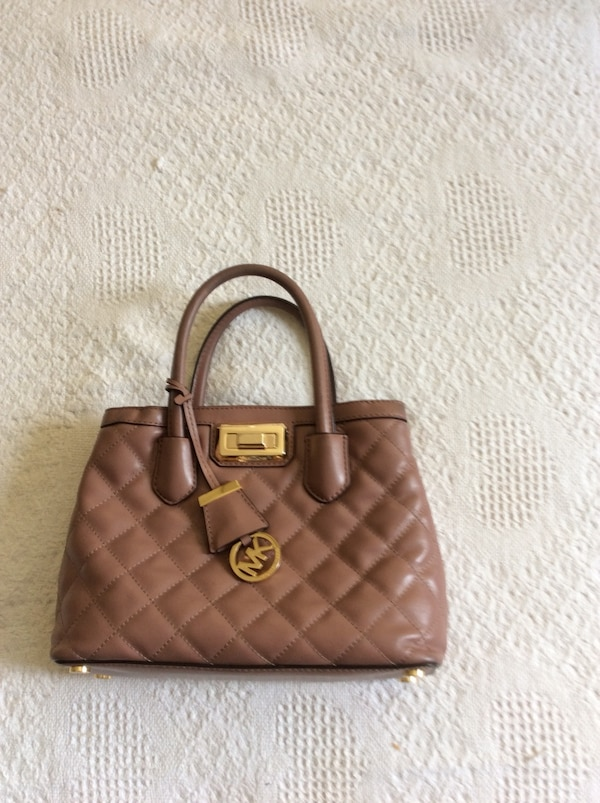 617f4c177edb Used WOW! Lowered price. Authentic M K leather bag. for sale in Dorval -  letgo