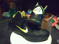 pair of black-and-green Nike basketball shoes Portland
