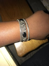 silver-colored bracelet with black leather strap Saint Paul, 55106