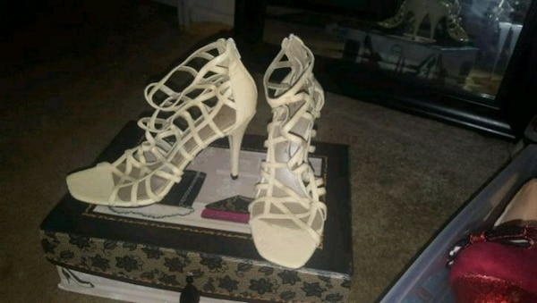 9145a09b3687 Used pair of white leather gladiator sandals for sale in Shelbyville ...