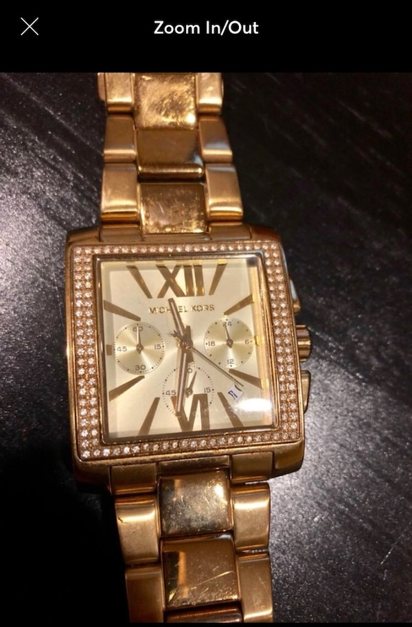 square gold Michael Kors chronograph watch with gold link bracelet
