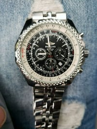 round silver chronograph watch with link bracelet Toronto