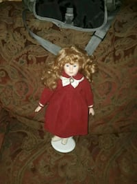 female doll wearing red dress Magee, 39111