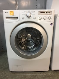 Ge white front load washer  Pompano Beach, 33069