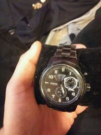 round black chronograph watch with link bracelet Edmonton, T5Y 0C5