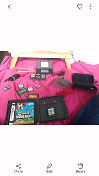 Red Nintendo ds with games  St. Albert, T8N 5R2