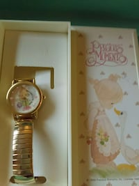 round gold Precious Moments analog watch with gold link strap in box Hamden