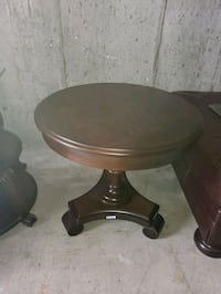 brown wooden round table with black metal base Islip Terrace, 11752