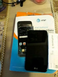 black LG android smartphone still with box. Toronto, M4C 1H7