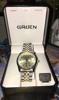 Woman's Vintage Gruen gold and silver tone link watch.Mint condition.