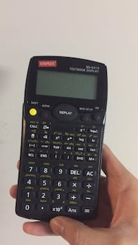 Black and gray texas instrument ti-84 plus calculator