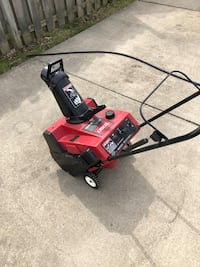 red and black Toro lawn mower