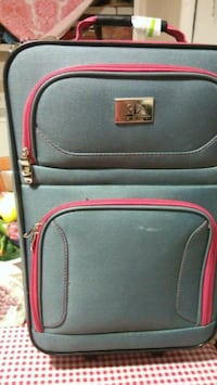 black and red travel luggage 2282 mi