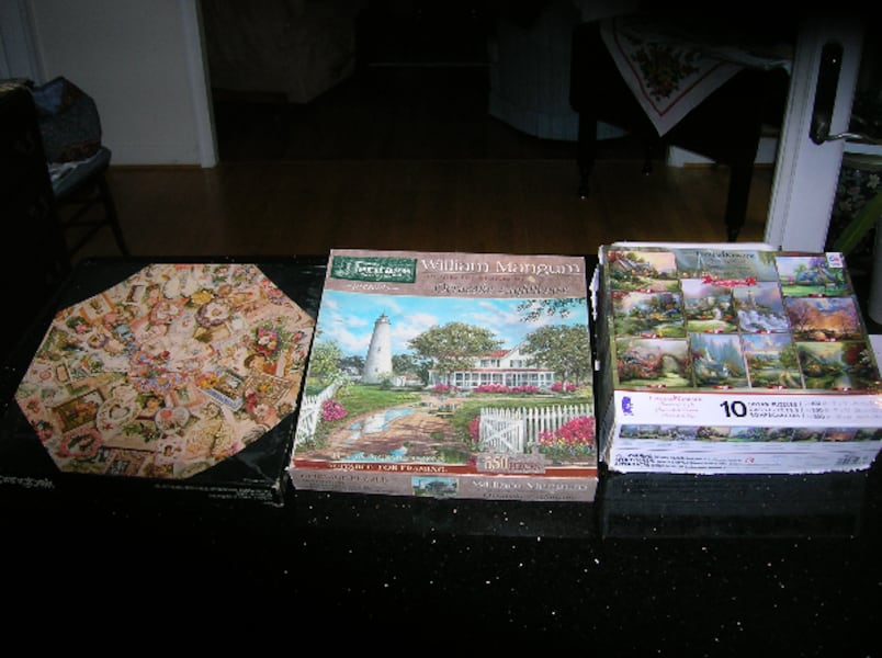 Three (3) Boxes of Multiple Piece Puzzles 7ba24335-d185-4768-8c96-1fd6d72aa922