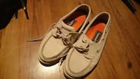 pair of white leather boat shoes