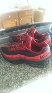 pair of red-and-black Nike running shoes Houston, 77088