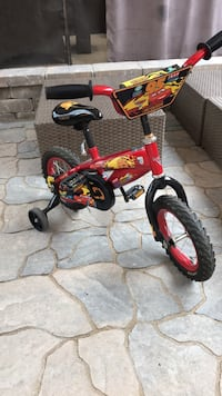 toddler's red and black bicycle with training wheels Vaughan, L6A 0E4