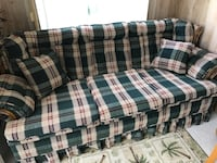 Plaid green couch with wood accents. Like new. Always covered. Never exposed to sun White Plains, 10603