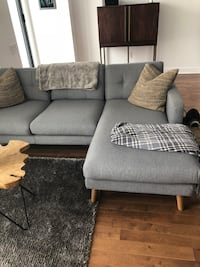 Must society grey couch 785 km