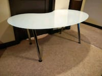 round white wooden table with black metal base Calgary, T3J 3T9