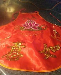 red and gold glittery apron Artesia, 88210