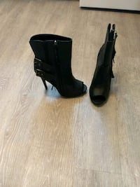 pair of black leather chunky heeled booties 792 km