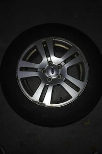 Gray 5-spoke car wheel with tire
