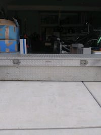 Diamond plate tool box for full size truck with sliding trey