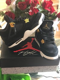 pair of black Air Jordan 4's with box
