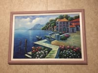 brown wooden framed painting of a boat dock
