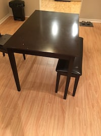 rectangular black wooden table with two chairs Toronto, M4W 2K9