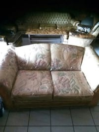 brown floral fabric loveseat