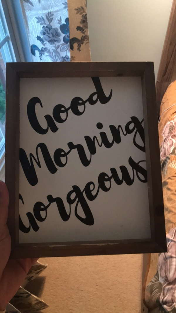 black and white wooden quote board