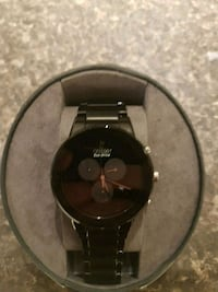 round black chronograph watch with link bracelet Guelph, N1G 2V6