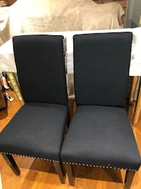 Black velvet  Brand new dinning room chairs.  Brand new in box and never used.  More than 4 chairs available! Different colours but same style. Has a studded design. All chairs come brand new in box. Chair legs are solid wood and Expresso.   Dimensions: B Toronto, M9V 4T4