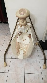 baby's white and brown cradle n swing