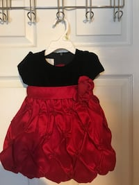 girl's black and red crew-neck cap-sleeved dress with flower accent. 18 months