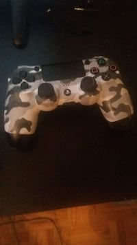 white and black Sony PS4 controller Mississauga, L5M 2A9