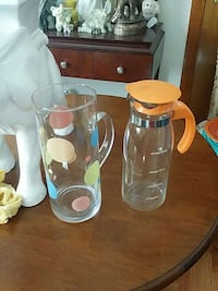 multicolored dotted clear glass pitcher and orange plastic handled clear glass pitcher East Hartford, 06108