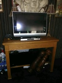 brown wooden TV stand with flat screen television Gulfport, 39503