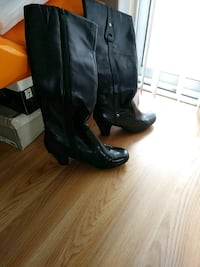 pair of black leather knee high boots Lakeland, 33813