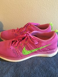 pair of pink Nike running shoes Rancho Cucamonga, 91730