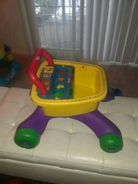 toddler's yellow, purple, and green Fisher-Price cart toy Randallstown