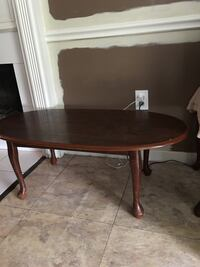 oval brown wooden table . Pearl, 39208