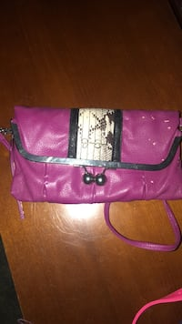 pink and black leather crossbody bag